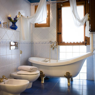 Small tuscan 3/4 blue tile, white tile and ceramic tile ceramic floor and blue floor bathroom photo in Barcelona with a bidet and blue walls