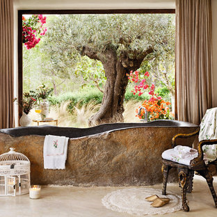 Inspiration for a mediterranean freestanding bathtub remodel in Other