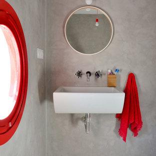 Ejemplo de cuarto de baño principal, contemporáneo, pequeño, con paredes grises, suelo de cemento, lavabo suspendido y suelo gris