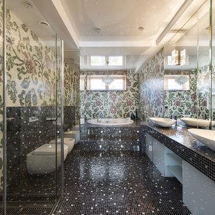 Ejemplo de cuarto de baño principal, actual, con armarios con paneles lisos, puertas de armario blancas, baldosas y/o azulejos multicolor, baldosas y/o azulejos en mosaico, jacuzzi, ducha a ras de suelo, sanitario de pared y lavabo sobreencimera