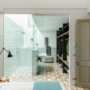 Example of a tuscan 3/4 white tile multicolored floor bathroom design in Barcelona with white walls and a wall-mount sink