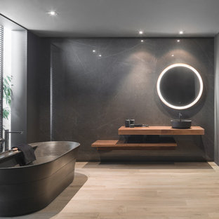 Example Of A Minimalist Master Light Wood Floor And Beige Floor  Freestanding Bathtub Design In Other
