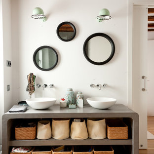 Bathroom - mid-sized mediterranean 3/4 light wood floor bathroom idea in Madrid with open cabinets, white walls and a vessel sink