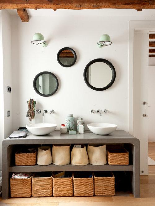mid sized modern 34 light wood floor bathroom idea in madrid with open
