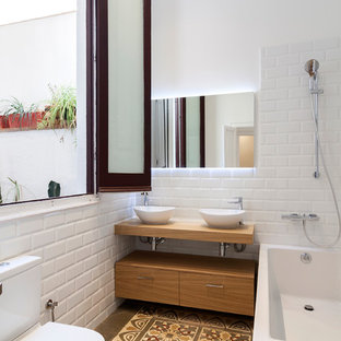 Bathroom - mid-sized scandinavian master white tile and subway tile ceramic floor bathroom idea in Barcelona with flat-panel cabinets, medium tone wood cabinets, a two-piece toilet, white walls, a vessel sink, wood countertops and brown countertops