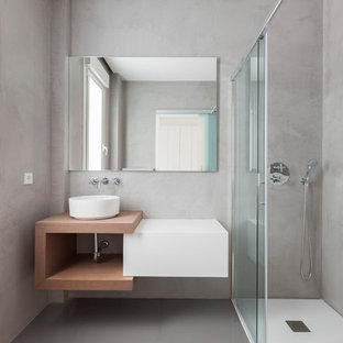 Inspiration for a mid-sized modern 3/4 bathroom in Madrid with flat-panel cabinets, white cabinets, a corner shower, grey walls, ceramic floors, a vessel sink, grey floor and a sliding shower screen.