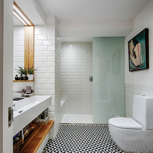 Bathroom - mid-sized contemporary 3/4 white tile bathroom idea in Other with an urinal, white walls and a trough sink
