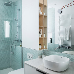 Trendy 3/4 blue tile, green tile and mosaic tile gray floor corner shower photo in Madrid with flat-panel cabinets, white cabinets, a vessel sink, a hinged shower door, a wall-mount toilet, white walls and white countertops