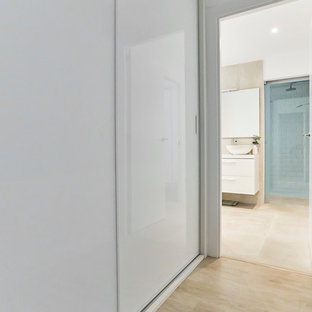 Bathroom - small scandinavian 3/4 beige tile and ceramic tile ceramic floor and beige floor bathroom idea in Other with flat-panel cabinets, white cabinets, multicolored walls, a console sink and white countertops