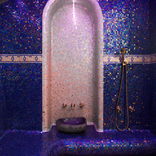This is an example of a mid-sized mediterranean master bathroom in Other with purple cabinets, blue tile, multi-coloured floor and purple benchtops.