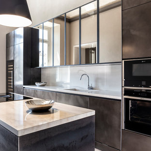 Design ideas for a contemporary galley kitchen in Other with an integrated sink, brown cabinets, beige splashback, black appliances, with island and beige benchtop.
