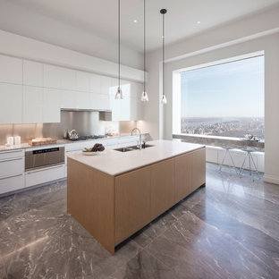 Photo of an expansive contemporary single-wall open plan kitchen in Florence with a double-bowl sink, flat-panel cabinets, white cabinets, metallic splashback, with island, stainless steel appliances and marble floors.