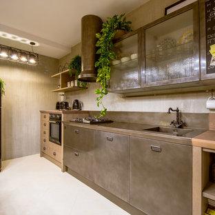 Ispirazione per una cucina industriale di medie dimensioni con ante lisce, ante in acciaio inossidabile, top in acciaio inossidabile, nessuna isola e pavimento bianco