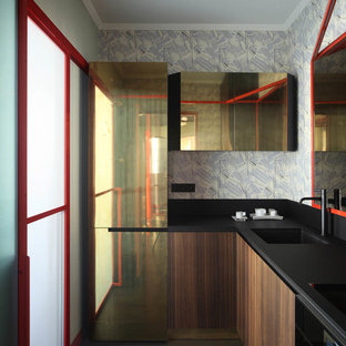 Small contemporary l-shaped separate kitchen in Venice with grey splashback, dark hardwood floors, black floor, an integrated sink, flat-panel cabinets, dark wood cabinets, coloured appliances and no island.