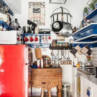 Design ideas for an eclectic galley kitchen in Florence with louvered cabinets, white cabinets, coloured appliances and grey benchtop.