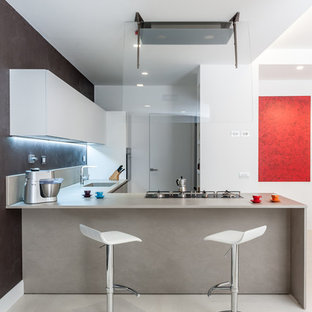 Inspiration for a mid-sized modern l-shaped open plan kitchen in Rome with an integrated sink, flat-panel cabinets, beige cabinets, quartzite benchtops, grey splashback, marble splashback, stainless steel appliances, painted wood floors, a peninsula and white floor.
