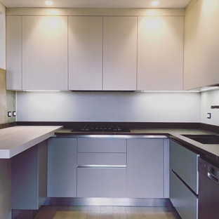 Photo of a mid-sized modern u-shaped eat-in kitchen in Other with an undermount sink, flat-panel cabinets, grey cabinets, limestone benchtops, brown splashback, limestone splashback, stainless steel appliances, painted wood floors, no island, brown floor and brown benchtop.