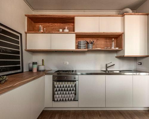 Foto e idee per cucine cucina for Cucina moderna marrone