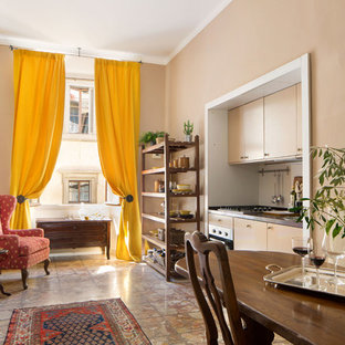 Photo of a small traditional single-wall eat-in kitchen in Florence with flat-panel cabinets, white splashback, marble floors and orange floor.