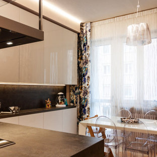 This is an example of a large contemporary l-shaped open plan kitchen in Bologna with glass-front cabinets, beige cabinets, solid surface benchtops, grey splashback, black appliances, marble floors, with island, pink floor, grey benchtop and recessed.