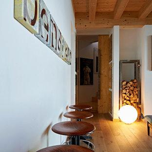 他の地域の巨大なコンテンポラリースタイルのおしゃれなキッチン (ドロップインシンク、フラットパネル扉のキャビネット、グレーのキャビネット、木材カウンター、シルバーの調理設備、無垢フローリング、茶色い床) の写真