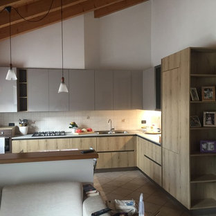 Photo of a large modern l-shaped eat-in kitchen in Other with a double-bowl sink, flat-panel cabinets, light wood cabinets, laminate benchtops, white splashback, ceramic splashback, stainless steel appliances, ceramic floors, no island, pink floor and grey benchtop.