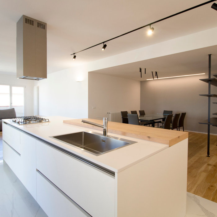 Inspiration for a contemporary single-wall light wood floor and brown floor open concept kitchen remodel in Catania-Palermo with a single-bowl sink, flat-panel cabinets, white cabinets, quartzite coun