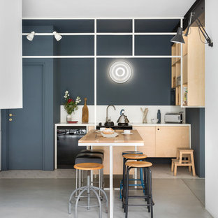 Contemporary open concept kitchen pictures - Open concept kitchen - contemporary single-wall concrete floor and gray floor open concept kitchen idea in Milan with open cabinets, light wood cabinets, white backsplash and black appliances