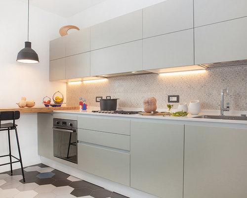 Foto e idee per cucine cucina con paraspruzzi con for Piastrelle paraspruzzi cucina