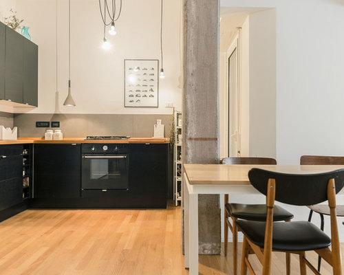 Cucina abitabile scandinava con ante nere foto e idee per