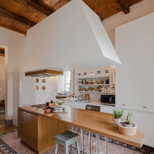 Inspiration for a mid-sized eclectic l-shaped open plan kitchen in Other with flat-panel cabinets, white cabinets, marble benchtops, grey splashback, marble splashback, marble floors, with island, multi-coloured floor, a double-bowl sink and white appliances.