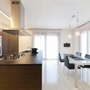 Esempio di una cucina contemporanea con lavello a doppia vasca, ante lisce, ante in legno scuro, elettrodomestici in acciaio inossidabile e top marrone