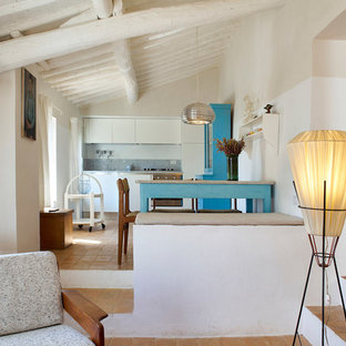 Mid-sized mediterranean eat-in kitchen remodeling - Mid-sized tuscan single-wall brick floor and orange floor eat-in kitchen photo in Florence
