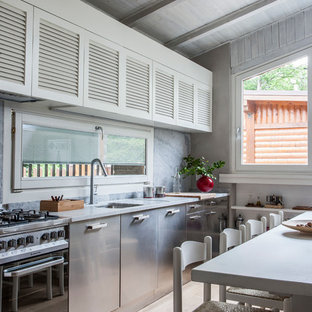 Design ideas for a mid-sized country single-wall eat-in kitchen in Florence with no island, an undermount sink, louvered cabinets, white cabinets, stainless steel appliances, light hardwood floors and beige floor.