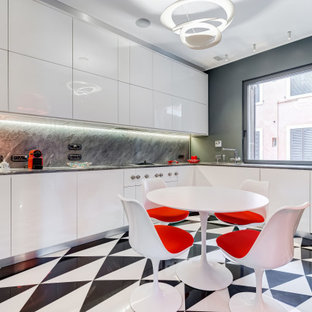 Design ideas for a mid-sized contemporary u-shaped open plan kitchen in Rome with white cabinets, grey splashback, no island, multi-coloured floor, grey benchtop, marble floors, an undermount sink, flat-panel cabinets, marble benchtops, marble splashback and stainless steel appliances.