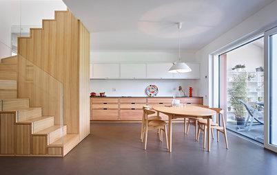 Innenausbau: Apartment mit multifunktionaler Treppe als Herzstück