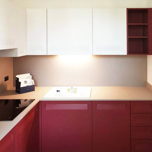 Small modern enclosed kitchen photos - Small minimalist l-shaped enclosed kitchen photo in Milan with a drop-in sink, flat-panel cabinets, pink cabinets, laminate countertops, beige backsplash, no island and beige countertops