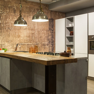 Inspiration for a large industrial kitchen in Naples with flat-panel cabinets, white cabinets, stainless steel appliances, with island, a drop-in sink, medium hardwood floors and quartz benchtops.