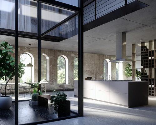 Réalisation dune grande cuisine ouverte parallèle minimaliste avec un placard à porte plane et