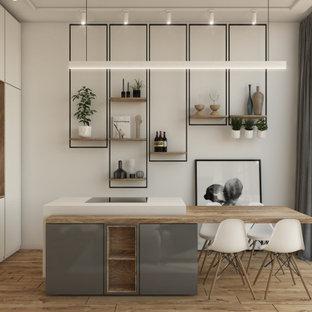 トゥーリンの巨大なコンテンポラリースタイルのおしゃれなキッチン (アンダーカウンターシンク、フラットパネル扉のキャビネット、白いキャビネット、木材カウンター、茶色いキッチンパネル、木材のキッチンパネル、シルバーの調理設備、無垢フローリング、茶色い床、茶色いキッチンカウンター) の写真