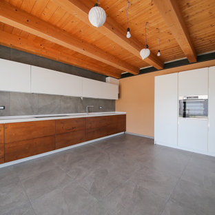 Design ideas for a large contemporary l-shaped open plan kitchen in Other with an integrated sink, flat-panel cabinets, quartz benchtops, white splashback, stainless steel appliances, porcelain floors, grey floor, white benchtop, medium wood cabinets, porcelain splashback and no island.