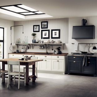 Design ideas for a small vintage single-wall open plan kitchen in Other with a single-bowl sink, recessed-panel cabinets, white cabinets, laminate countertops, no island and brown worktops.