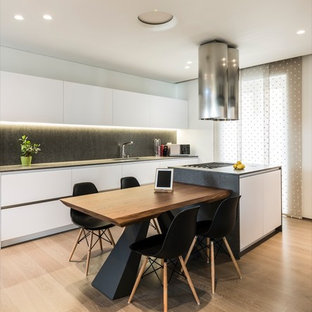 Design ideas for a mid-sized modern single-wall open plan kitchen in Bari with an integrated sink, open cabinets, white cabinets, quartz benchtops, stainless steel appliances, painted wood floors and with island.