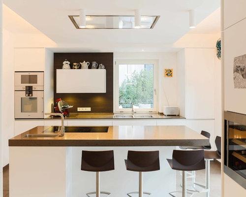 Cuisine lin aire avec un plan de travail en b ton photos for Amenagement cuisine lineaire
