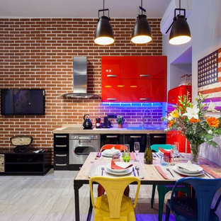 Small industrial open concept kitchen ideas - Inspiration for a small industrial porcelain floor open concept kitchen remodel in Rome with a single-bowl sink, flat-panel cabinets, red cabinets, wood countertops, red backsplash, porcelain backsplash and stainless steel appliances