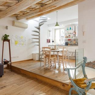 Ispirazione per una grande cucina boho chic con pavimento in legno massello medio