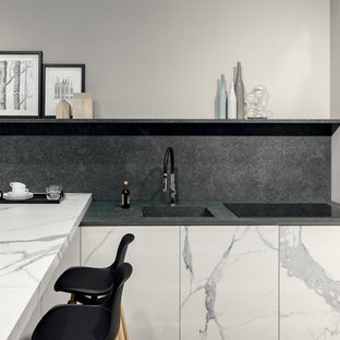 Inspiration for a small modern l-shaped open plan kitchen with an integrated sink, white cabinets, tile benchtops, grey splashback, porcelain splashback, porcelain floors, a peninsula and white benchtop.