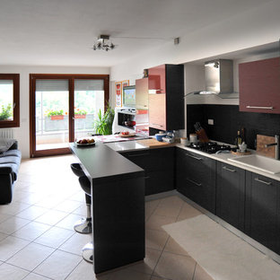 Design ideas for a small contemporary u-shaped open plan kitchen in Venice with a single-bowl sink, flat-panel cabinets, grey cabinets, quartz benchtops, black splashback, slate splashback, stainless steel appliances, ceramic floors, a peninsula and pink floor.