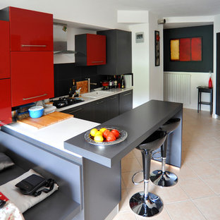 Photo of a small contemporary u-shaped eat-in kitchen in Venice with a single-bowl sink, flat-panel cabinets, grey cabinets, quartz benchtops, black splashback, slate splashback, stainless steel appliances, ceramic floors, a peninsula and pink floor.