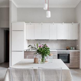 Idee per una piccola cucina lineare scandinava con pavimento in gres porcellanato e pavimento grigio